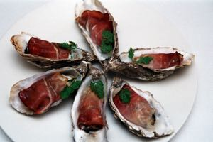 Grilled Oysters with Herb Chevre and Parma Ham