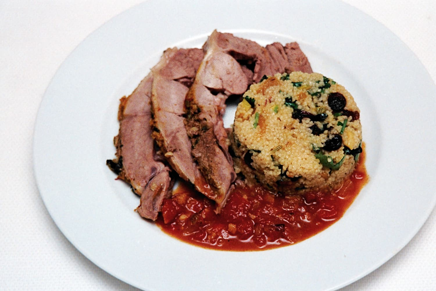 Steamed North African Leg of Lamb with Fruit Cous Cous served