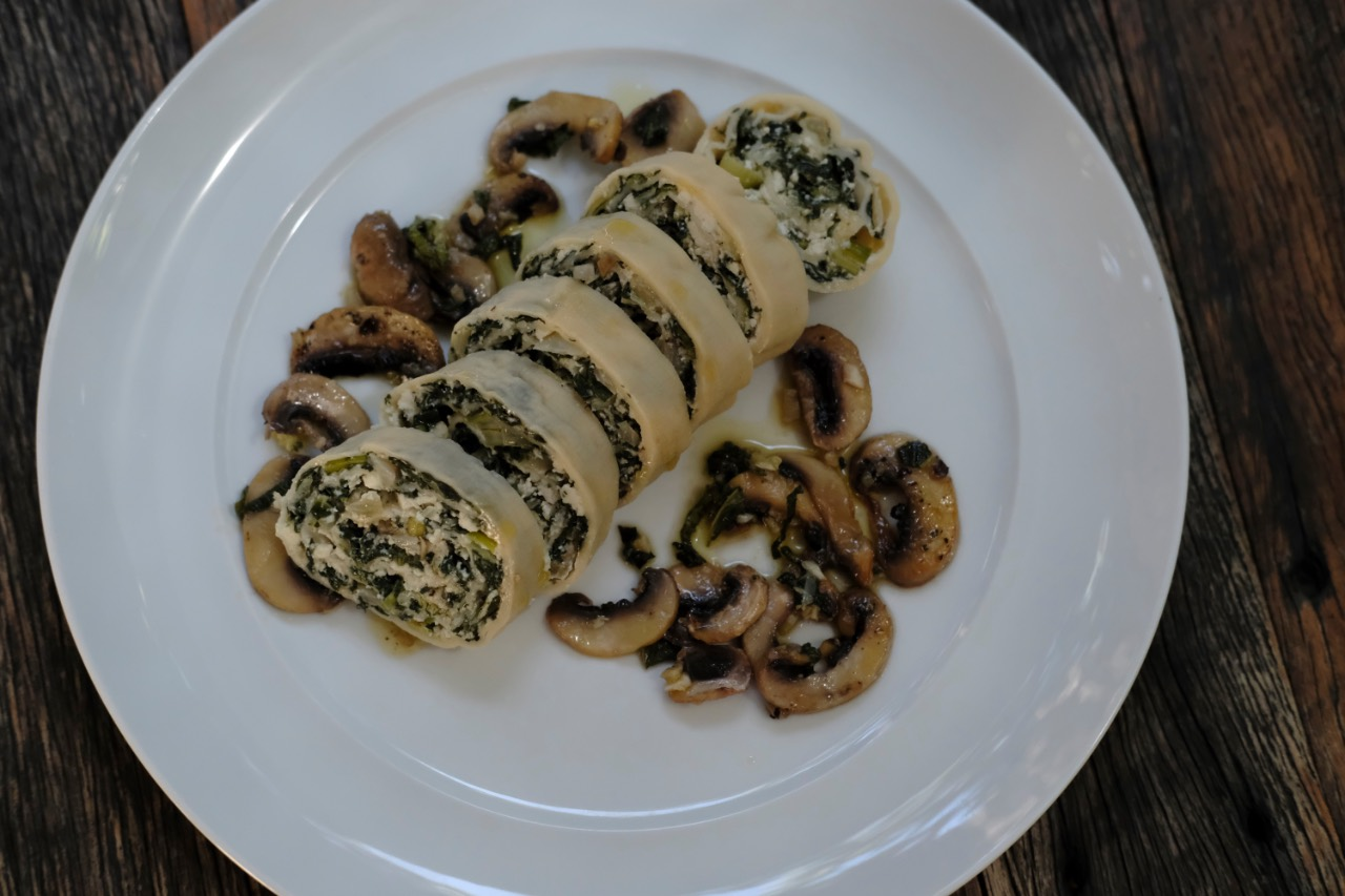Swiss Chard Pasta Roll, served with pan fried mushrooms