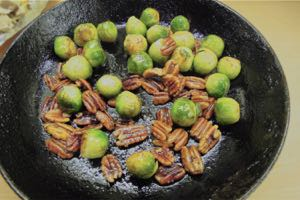 Sauté the Brussle Sprouts and Pecans in butter